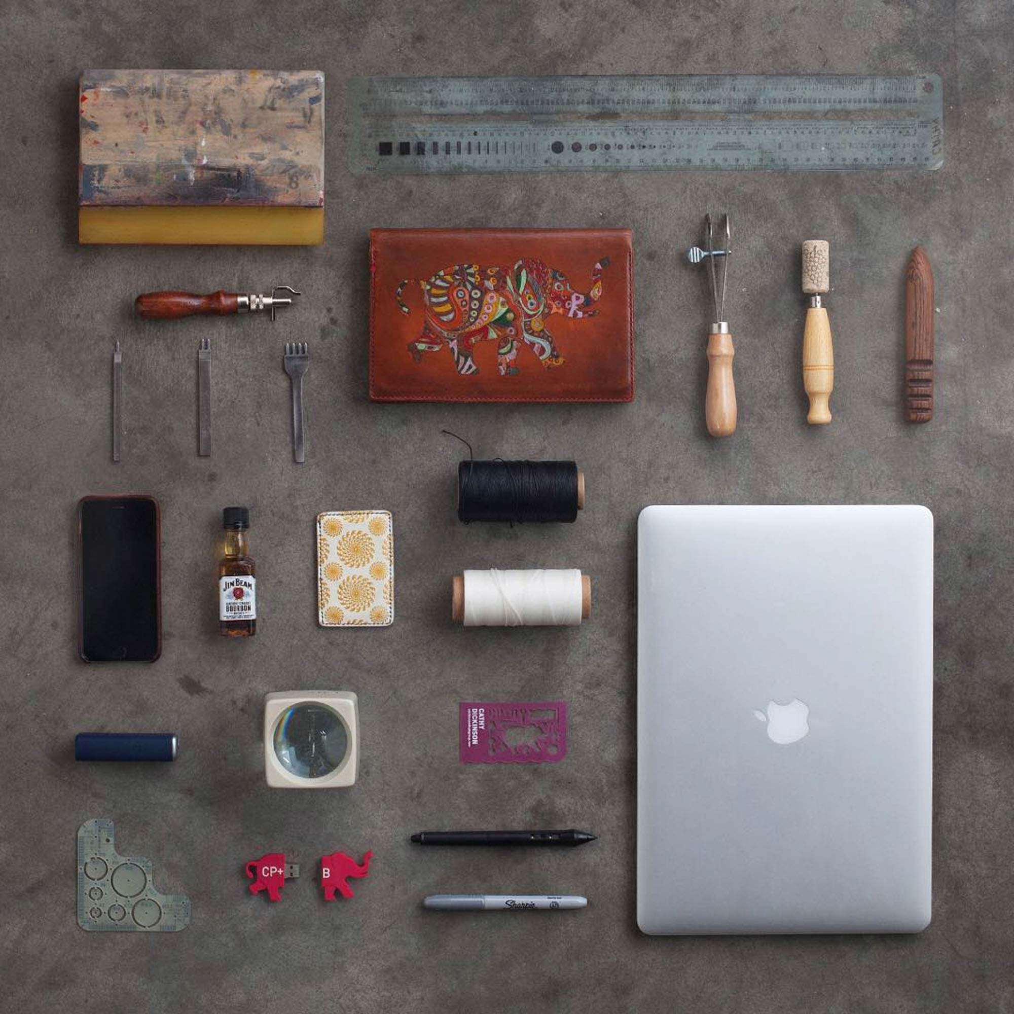 Knolling photography of items found on the desk of art department artist at Crispin Porter + Bogusky | Still Life Photography | Shot in Boulder, Colorado for Crispin Porter + Bogusky