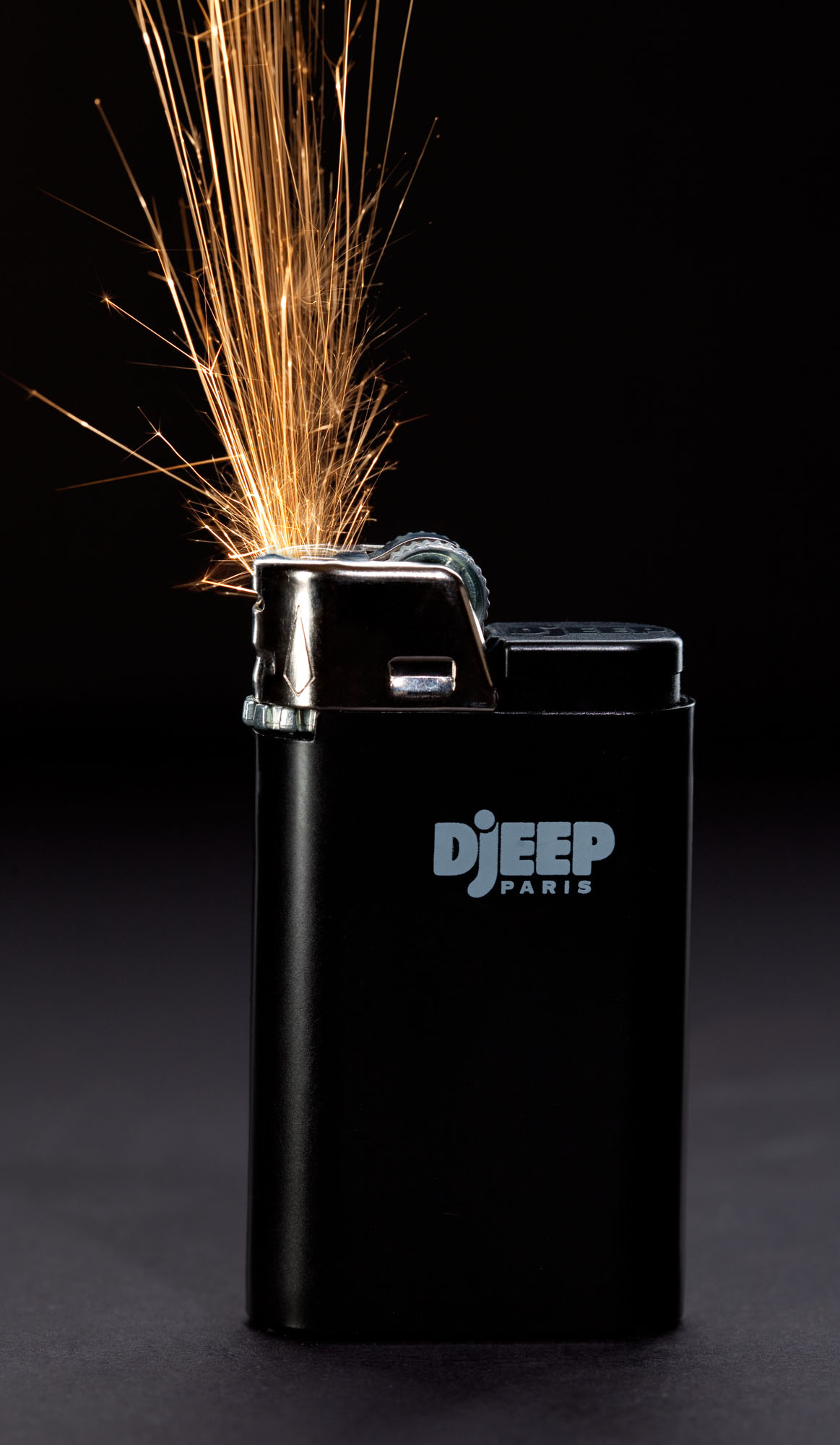 Dramatic product photography of sparks coming from Djeep Lighter | Special Effects | Fire | Shot in Denver, Colorado