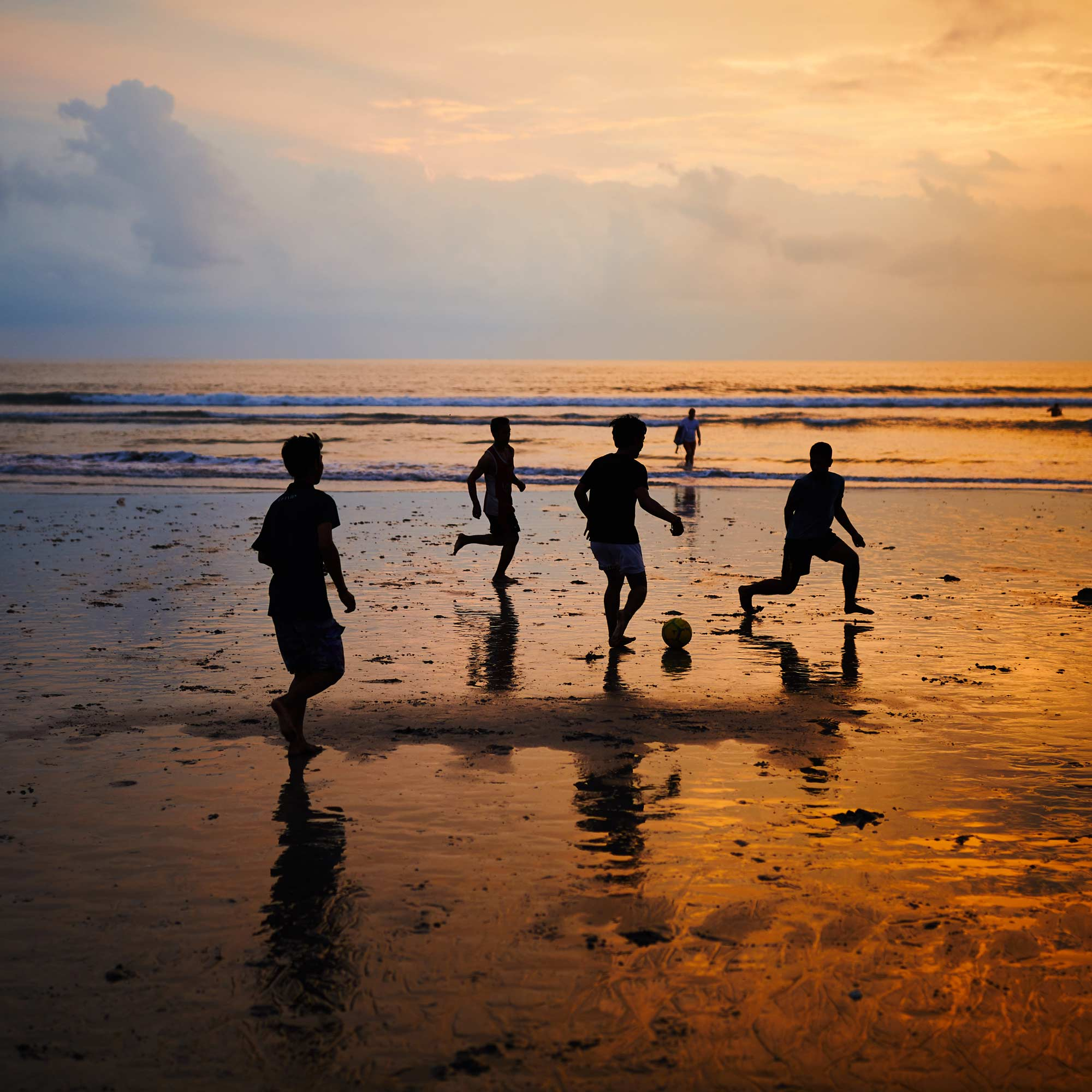 Boys playing soccer on a beach during sunset in Bali, Indonesia | Travel Photography