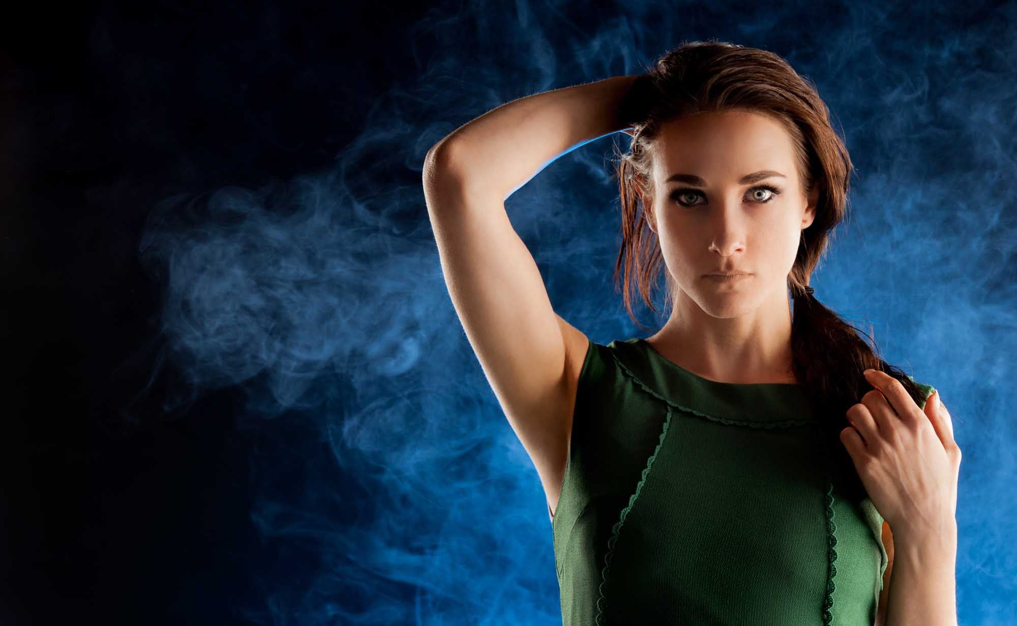 Portrait of model with dramatic lighting and smoke in background | Fashion Photography