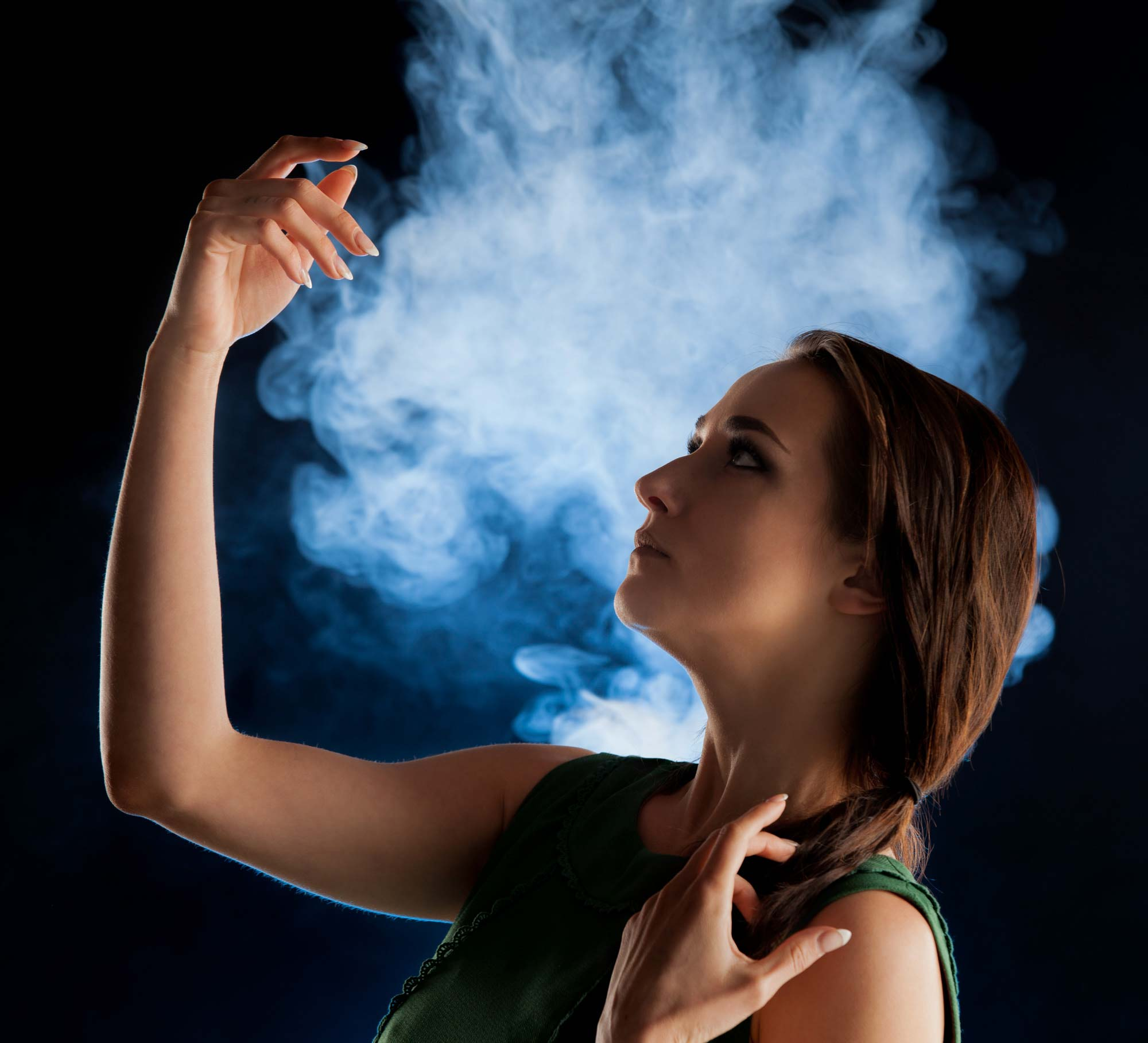 Woman in dramatic portrait with smoke in background | Fashion Photography