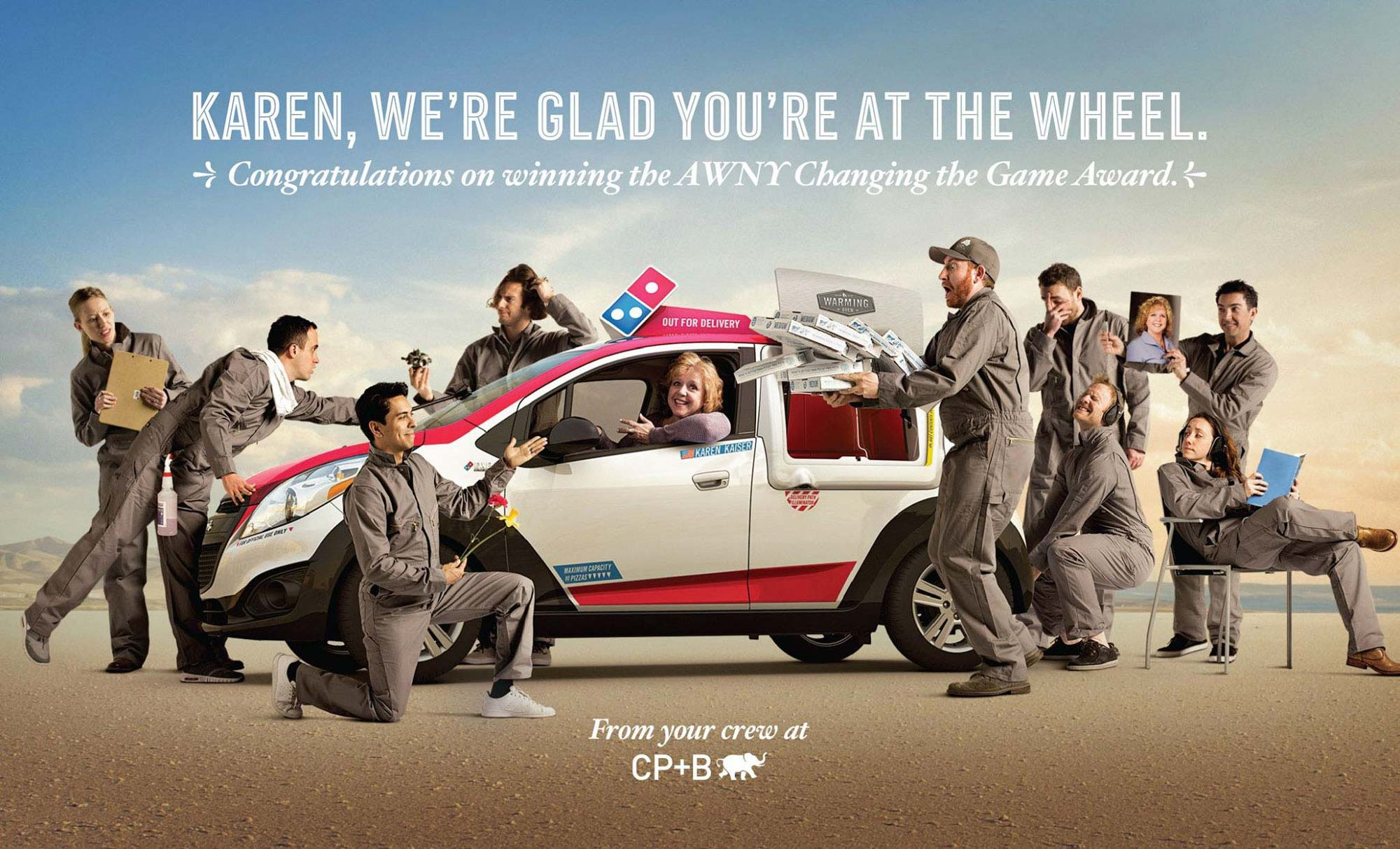 Domino's CMO Karen Kaiser in delivery car surrounded by CP+B creative team, fun silly photo, thank you award | Matt Talbot | Andrew Lincoln | Tony Calcao | Marthon Pucci | Maria Snell | Brian Caruso | Alex Guerri | Sean Wright | Brittany Tangsrud | Shot i