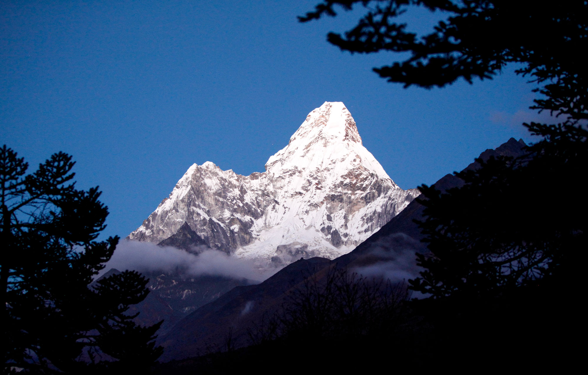 Ama Dablam mountain from far distance surrounded by dark trees near sunset | Hamalayas | Travel Photography | Trekking