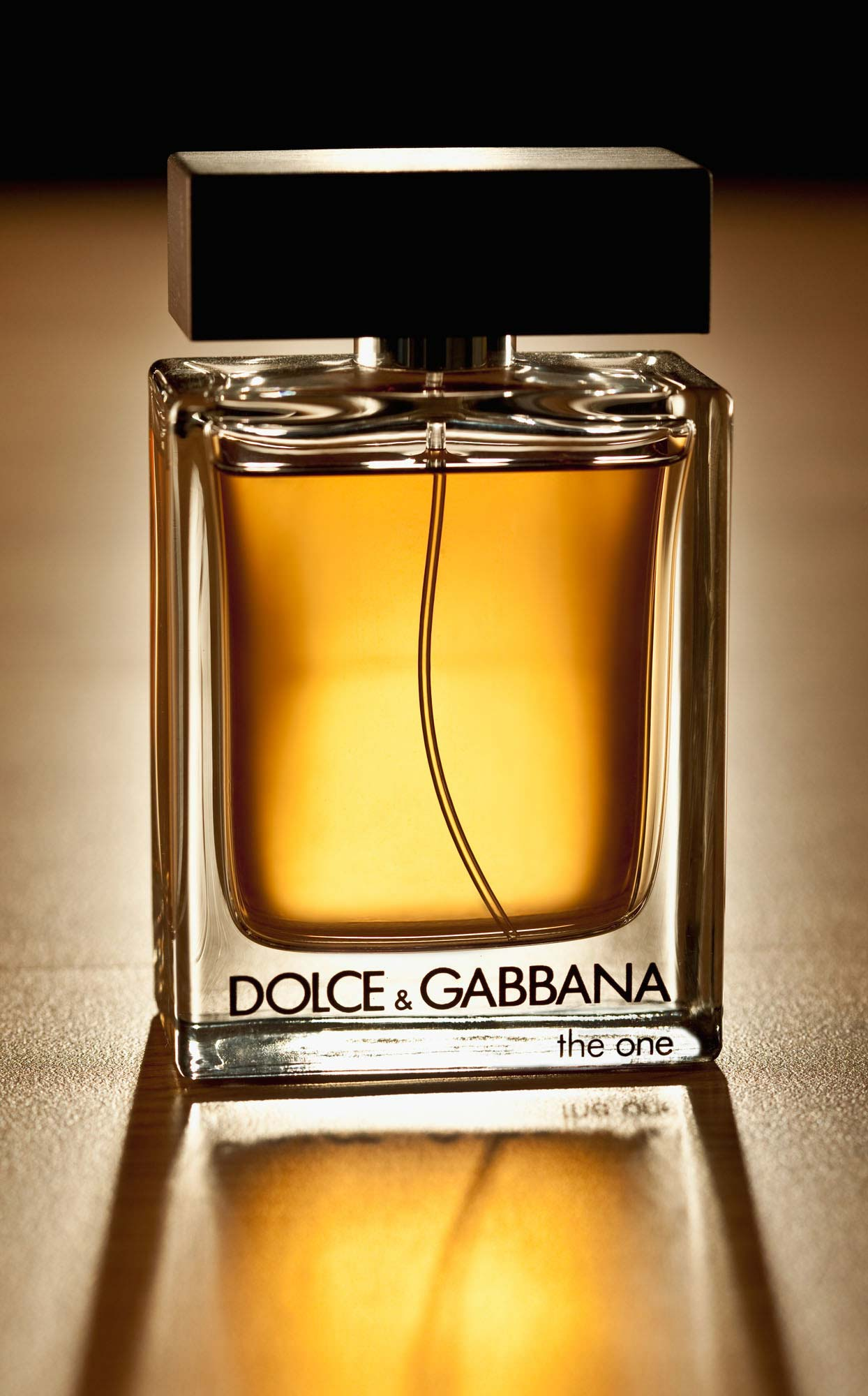 Dolce & Gabbana Cologne on wood table, product photography with dramatic lighting  | Still Life Photography | Shot in Denver, Colorado