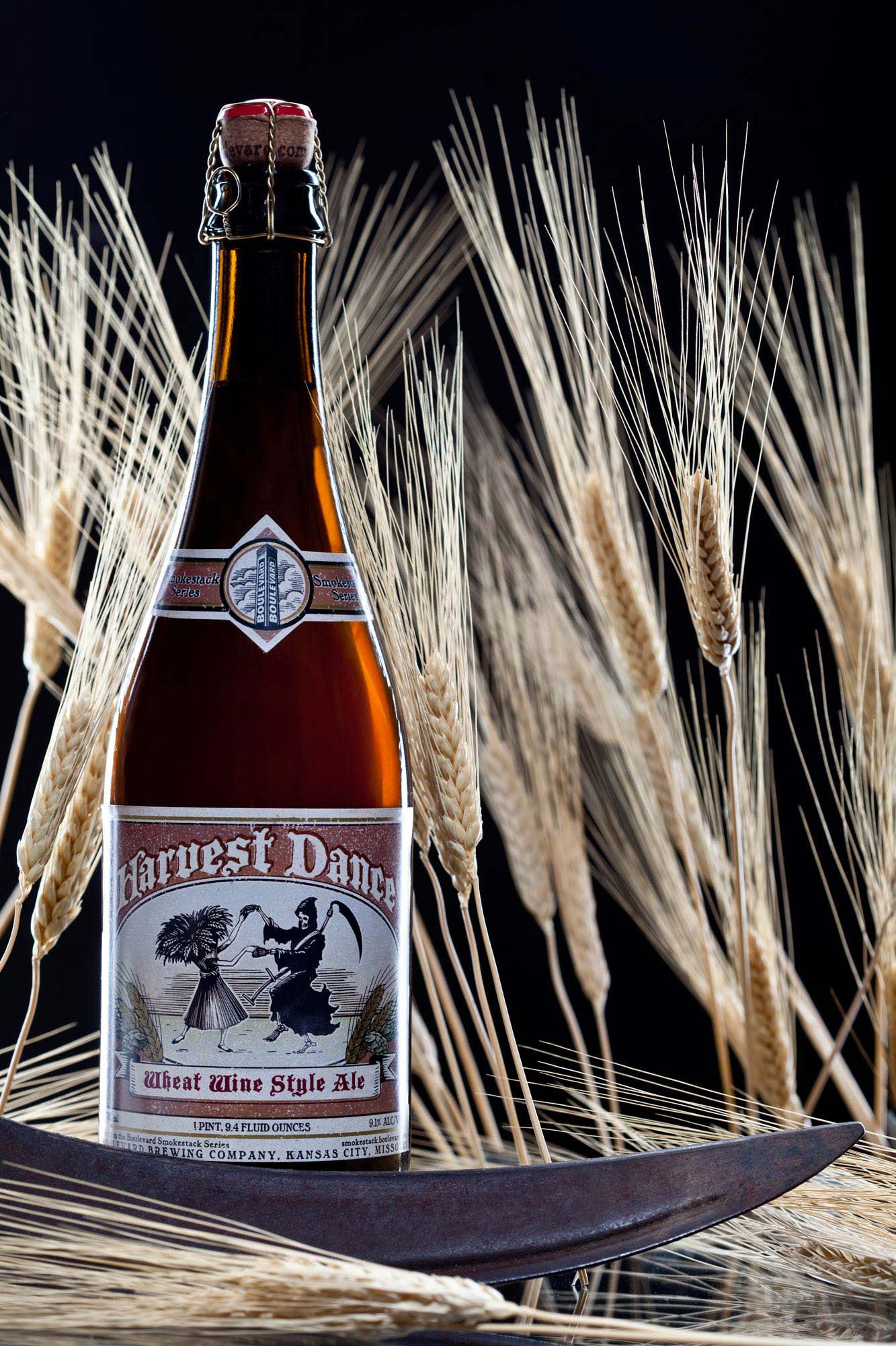 Still life of Boulevard Beer - Harvest Dance | Wheat and Sickle | Dramatic product photography | Bottle Photography | Shot in Denver Colorado