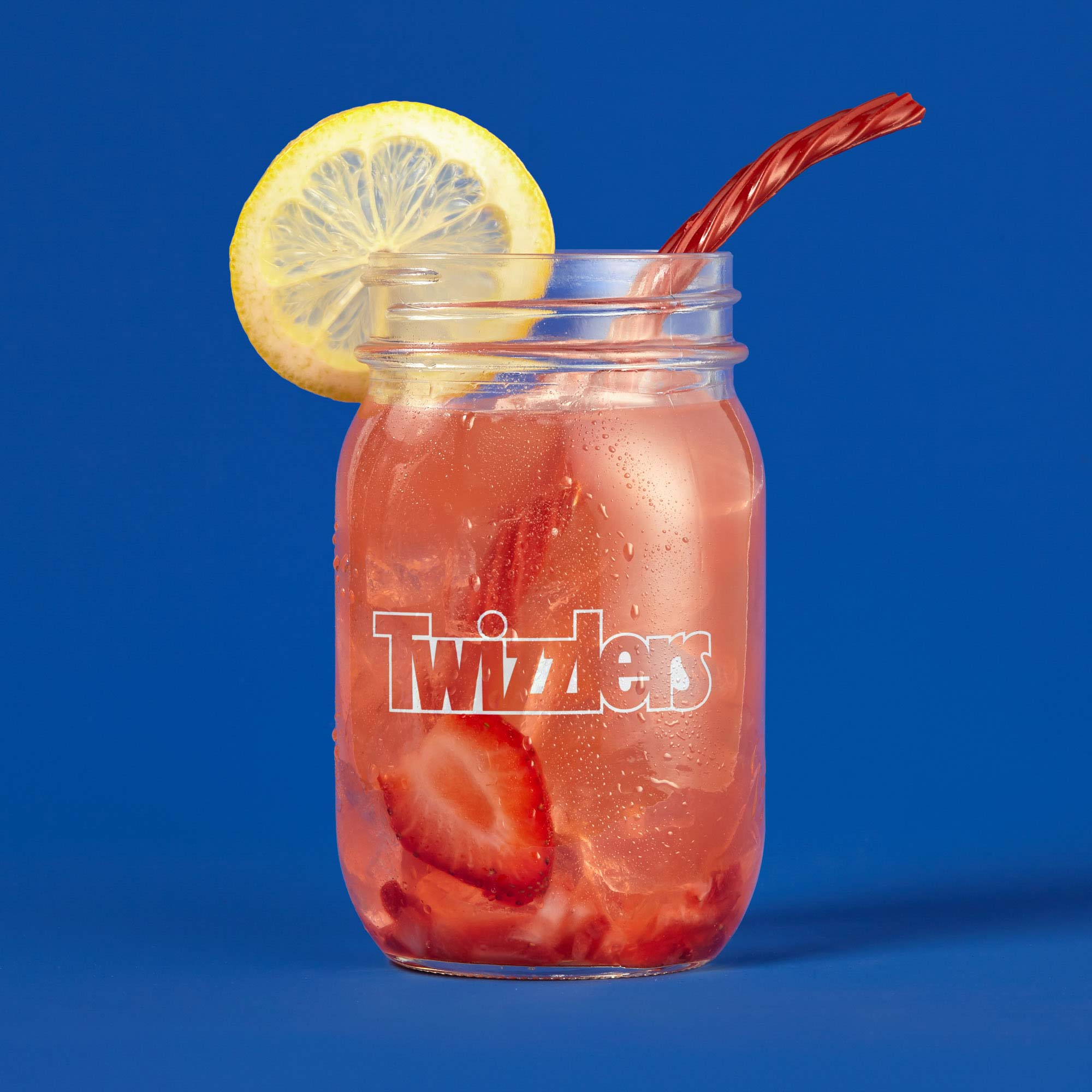 Twizzlers straw in pink lemonade on blue background | Food Photography | Studio Photography | Social | Still Life Photography shot in Boulder, Colorado for Crispin Porter + Bogusky