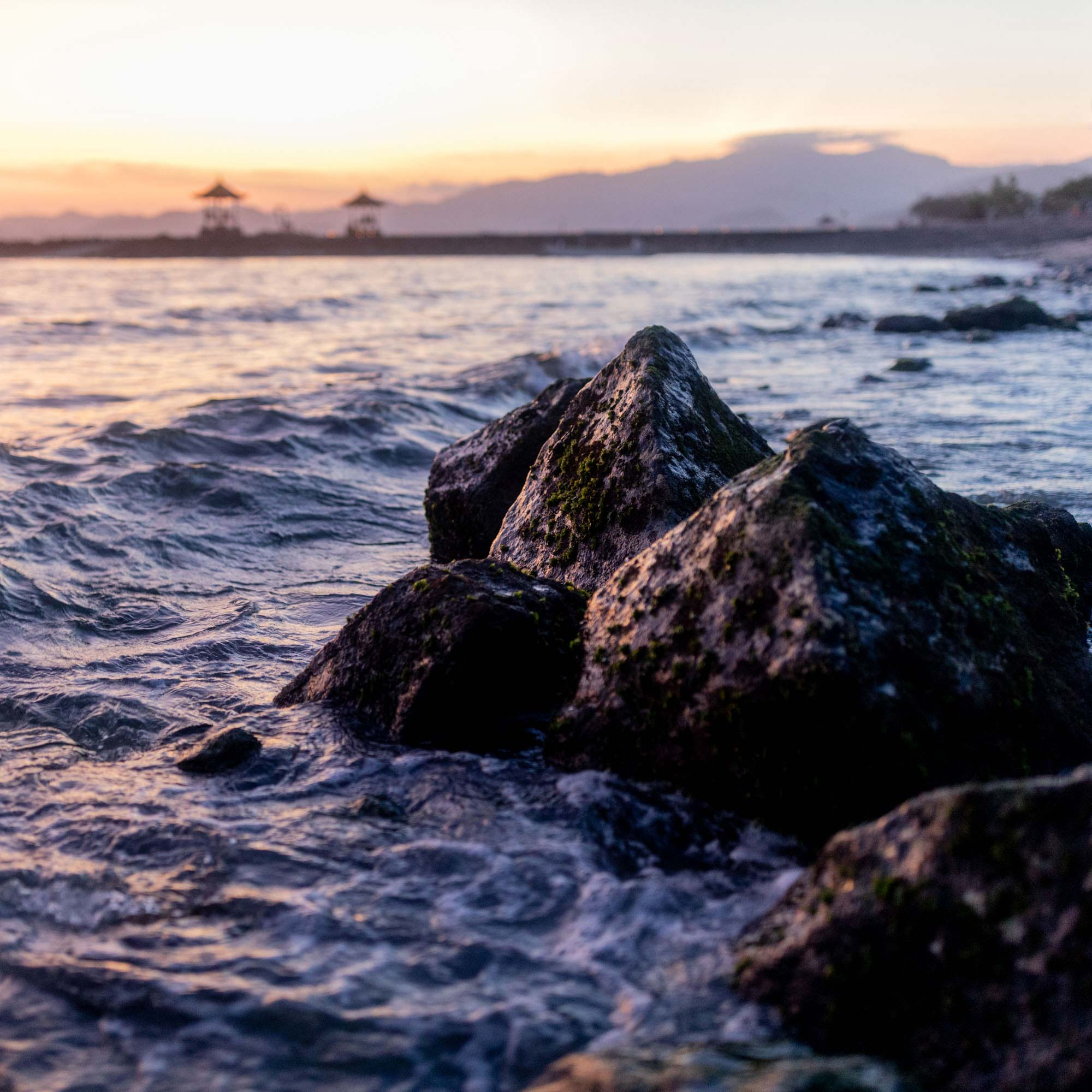 Rocks in water at sunset on beach in Bali, Indonesia | Travel Photography | Nature Photography