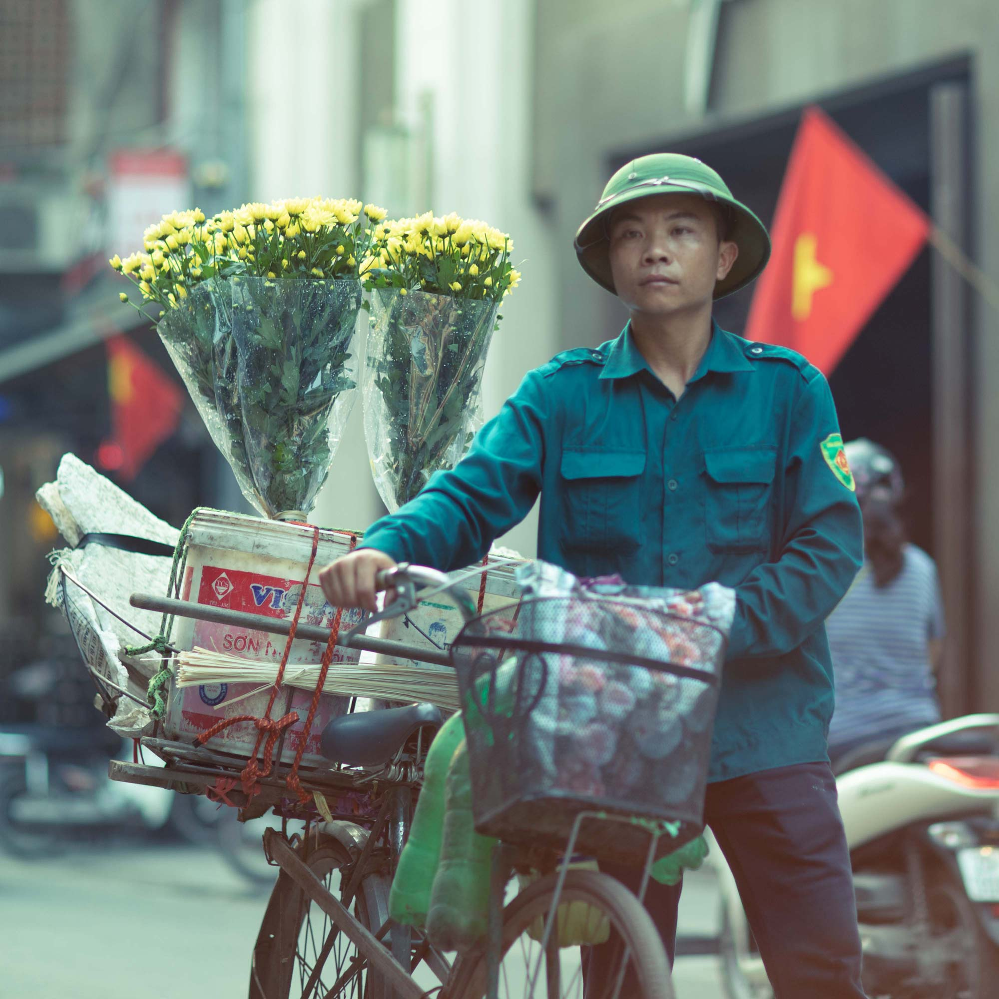 Street Photography of Man with bike and flowers in Hanoi, Vietnam | Travel Photography