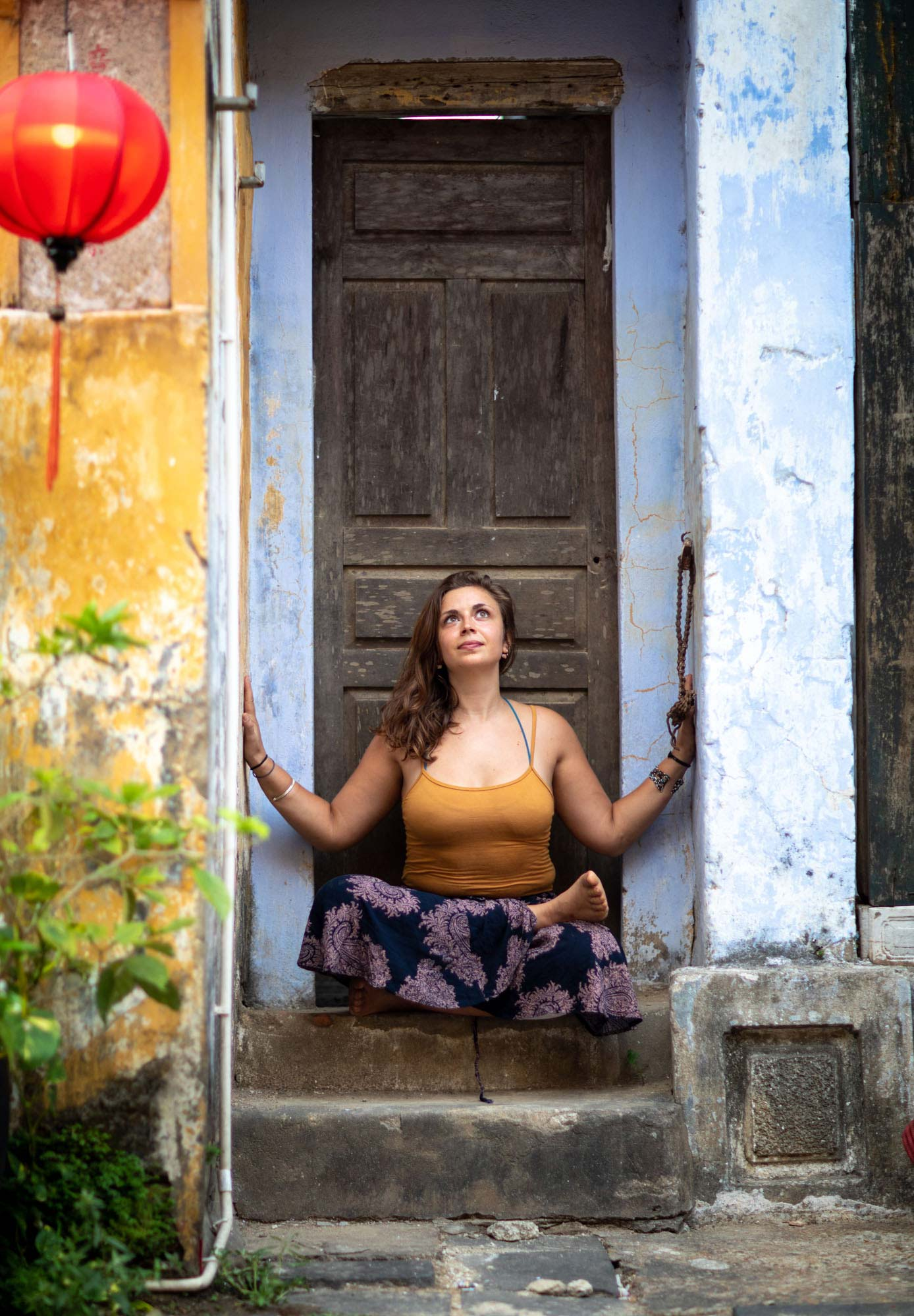 Woman meditating in doorway | Hoi An Vietnam | Yoga Photography | Travel Photography